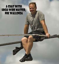High wire walker Nik Wallenda talks with spectators as he balances on a 1,200 foot-long cable during a practice session in Sarasota, Florida